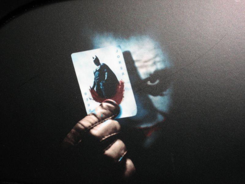 Joker/Batman painting on matte black Rolls Royce at Monte Carlo Casino, Monaco